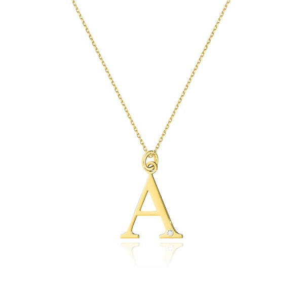 Złota zawieszka litera A z brylantem i łańcuszkiem
